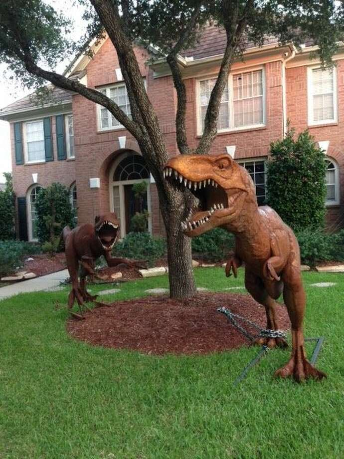 A Sugar Land woman, Nancy Hentschel, who has been told to remove two hulking dinosaur replicas from her front yard said the fearsome figures will go. Photo: Nancy Hentschel, Dino