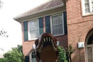 Sugar Land woman's front yard dinosaurs may soon be on the move - Photo