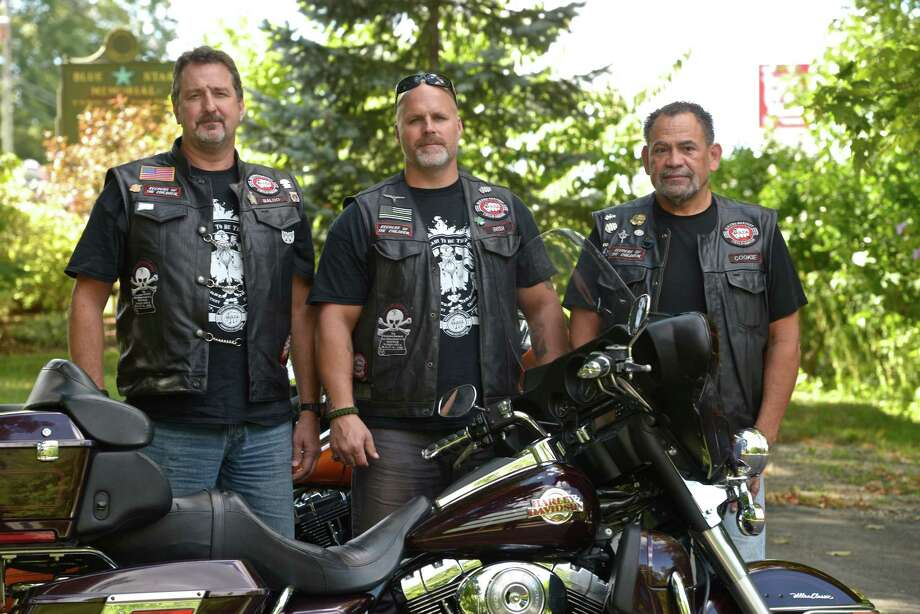 """Baloo, left, Irish and Cookie, right, from """"Bikers Against Child Abuse."""" an organization committed to protecting children and helping victims of child abuse. BACA is starting a chapter in western Connecticut, similar to the one in eastern Connecticut. Members of the organization do not use their real names to protect themselves and their families. Photo: H John Voorhees III / Hearst Connecticut Media / The News-Times"""