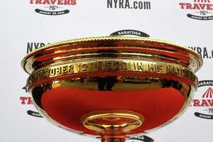 Have your picture taken with Travers trophy Monday - Photo