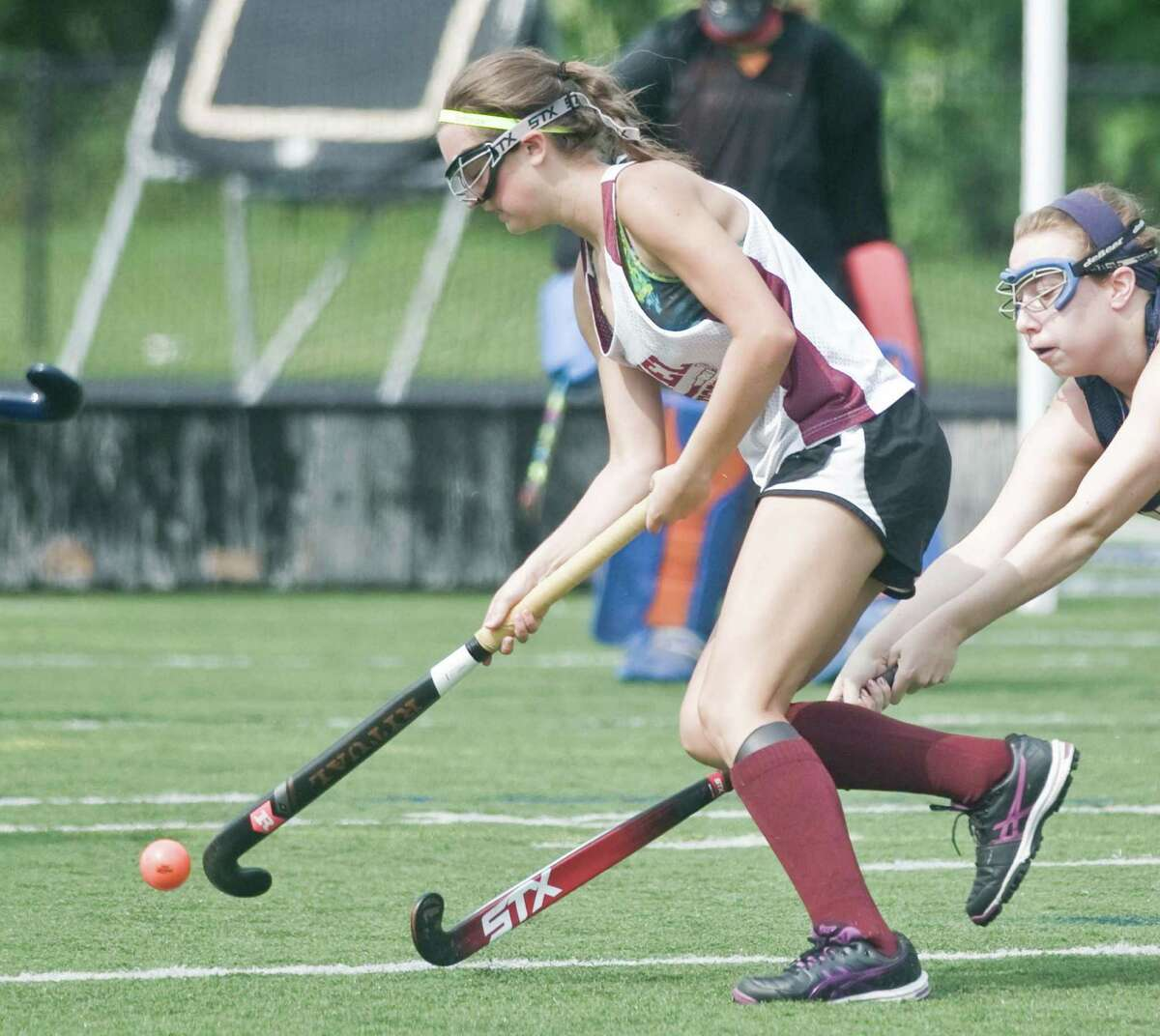 Bethel High School's Samantha Segiet moves the ball during the high school field hockey jamboree at Immaculate High School. Sunday, Aug. 30, 2015