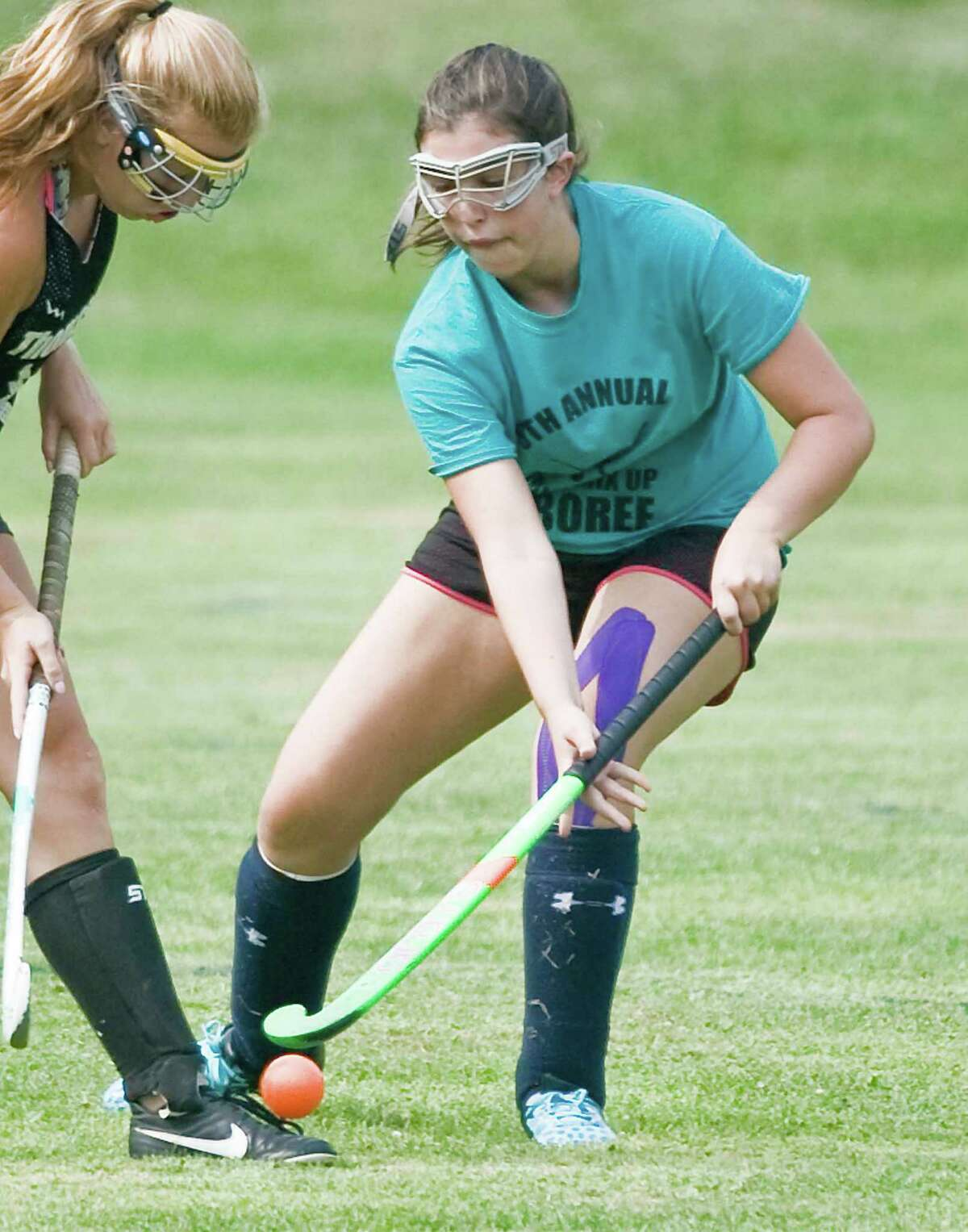 Immaculate High School's Lauren Garvey tries to gain control of the ball during the high school field hockey jamboree at Immaculate High School. Sunday, Aug. 30, 2015