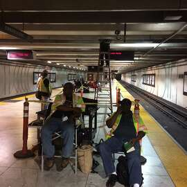 Workers on the job -- or not -- at the Embarcadero BART Station on Aug. 13 at 11 p.m.