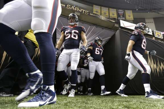 Houston Texans players run onto the field before an NFL pre-season football game against the New Orleans Saints at the Mercedes-Benz Superdome on Sunday, Aug. 30, 2015, in New Orleans. ( Brett Coomer / Houston Chronicle )