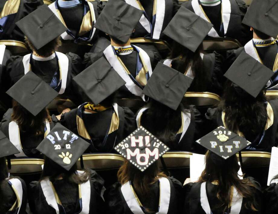 According to a new survey, nearly half of parents who haven't paid off their own student loans have saved at least $5,000 toward college costs for each of their children. Photo: Bob Donaldson /Pittsburgh Gazette / Pittsburgh Post-Gazette
