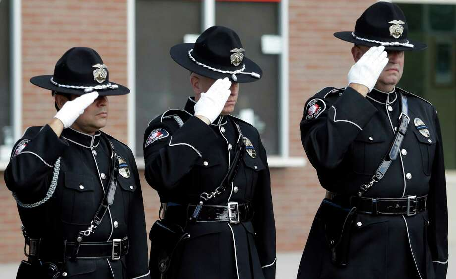Firerighters salute as a motorcade passes before a memorial service for three firefighters killed in a wildfire, Sunday, Aug. 30, 2015, in Wenatchee, Wash. Firefighters Richard Wheeler, Andrew Zajac and Thomas Zbyszewski died Aug. 19 in a fire near Twisp, Wash. Photo: Elaine Thompson, AP / AP