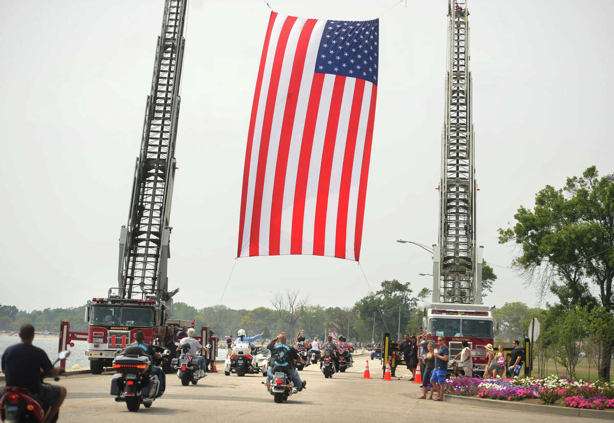 The 15th Annual United Ride, the state's largest 9/11 tribute, arrives in Seaside Park in Bridgeport, Conn. on Sunday, August 30, 2015. About 4,000 motorcycles, many flying American flags, take a 60-mile scenic route from Norwalk to Bridgeport.
