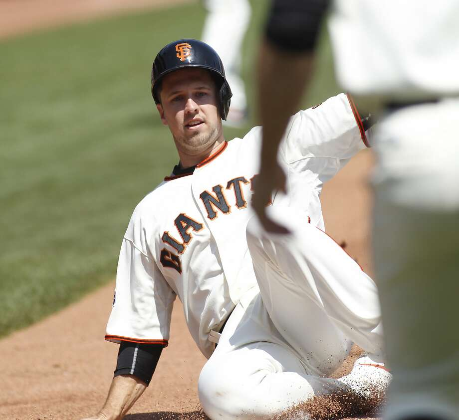 San Francisco Giants' Buster Posey scores against the St. Louis Cardinals during the first inning of a baseball game, Sunday, Aug. 30, 2015, in San Francisco. (AP Photo/George Nikitin) Photo: George Nikitin, Associated Press