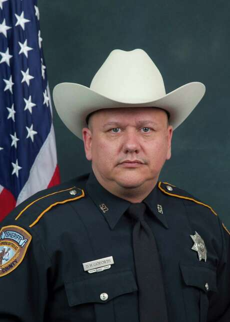 In a handout from the Harris County Sheriff's Office, Darren Goforth, a deputy who was fatally shot while filling his gas tank in suburban Houston on Aug. 29, 2015. No one has been charged and investigators do not yet know a motive for the execution-style killing, which followed two recent deaths of law enforcement officers in nearby Louisiana. (Harris County Sheriff's Office via The New York Times) -- FOR EDITORIAL USE ONLY. Photo: HARRIS COUNTY SHERIFF'S OFFICE, HO / New York Times / HARRIS COUNTY SHERIFF'S OFFICE