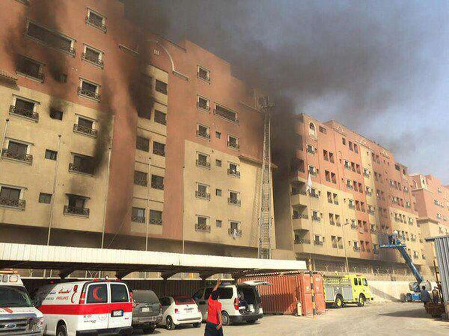 In this image released by the Saudi Interior Ministry's General Directorate of Civil Defense, smoke billows from a residential complex in Khobar, Saudi Arabia, Sunday, Aug. 30, 2015. A fire broke out at the residential complex used by the state oil giant Saudi Aramco. (Saudi Interior Ministry General Directorate of Civil Defense via AP) Photo: Uncredited, HOGP / Saudi Interior Ministry General