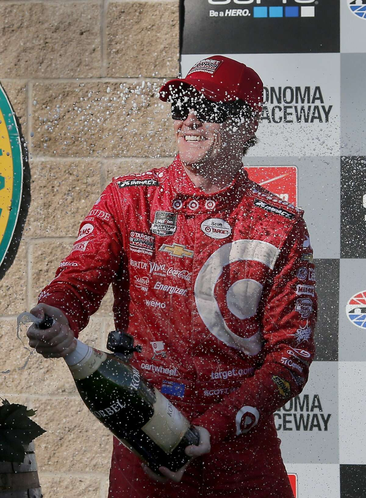 Scott Dixon celebrates with champagne after his race and season championship. Scott Dixon won the Go Pro Grand Prix of Sonoma and the overall IndyCar championship for 2015. The IndyCar GoPro Grand Prix of Sonoma attracted thousands of fans to Sonoma Raceway Sunday August 30, 2015.