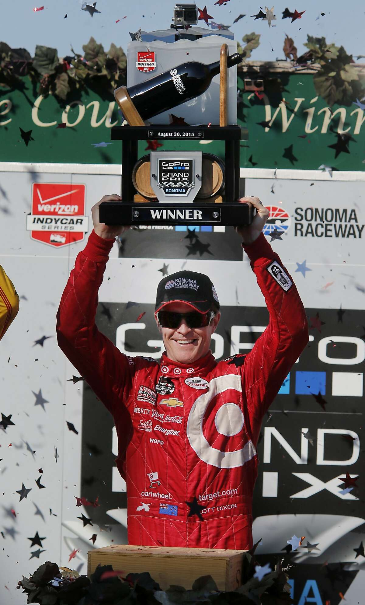 Scott Dixon held up his race trophy as graffiti fell. Scott Dixon won the Go Pro Grand Prix of Sonoma and the overall IndyCar championship for 2015. The IndyCar GoPro Grand Prix of Sonoma attracted thousands of fans to Sonoma Raceway Sunday August 30, 2015.