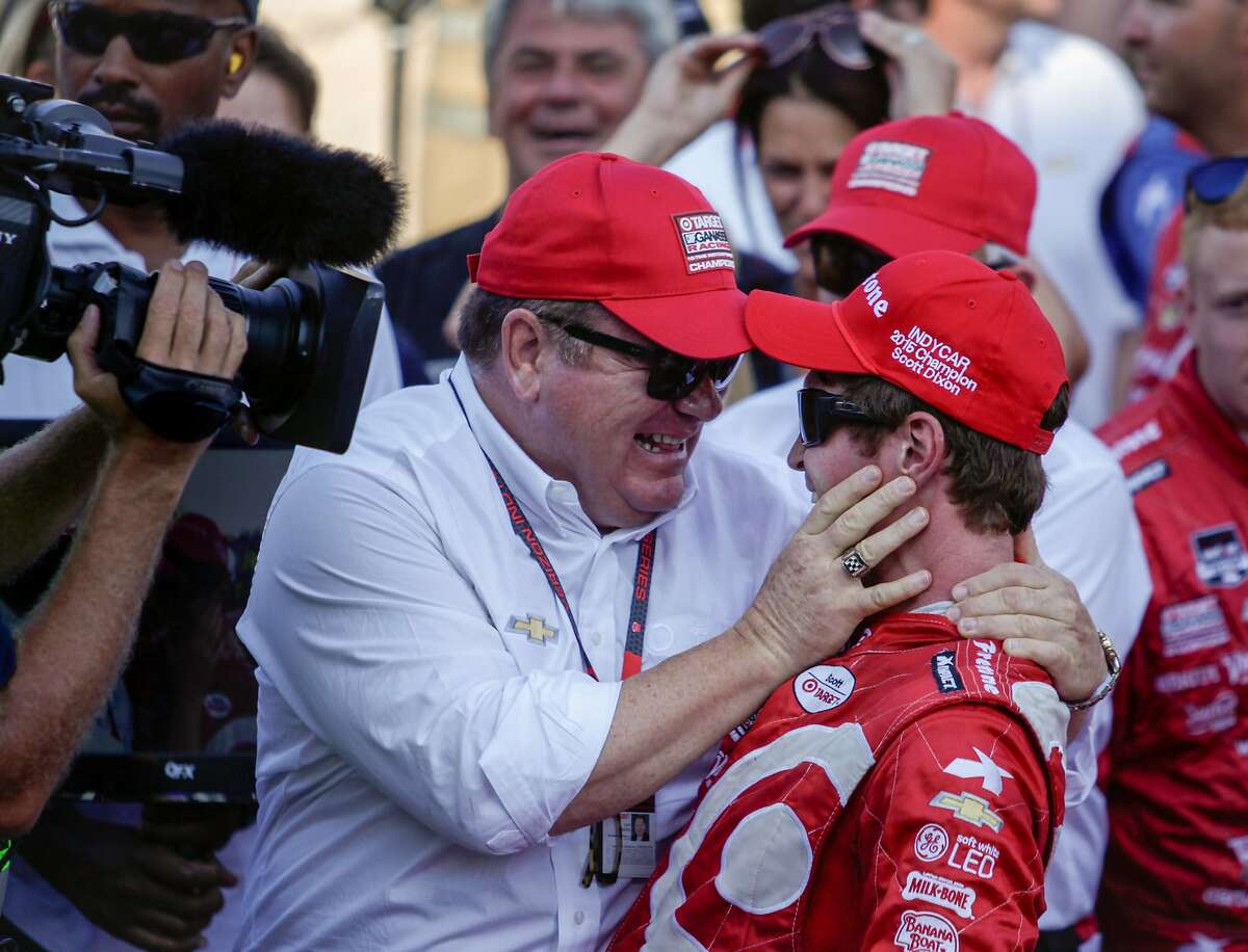 From left, Chip Ganassi, owner of the number 9 Target Chevorlet, celebrates with his driver, Scott Dixon, who won the GoPro Grand Prix at Sonoma Raceway on Sunday, Aug. 30, 2015 in Sonoma, Calif. Winning this round also elevated Dixon from third place in The Verizon Indy Car racing series to the champion.