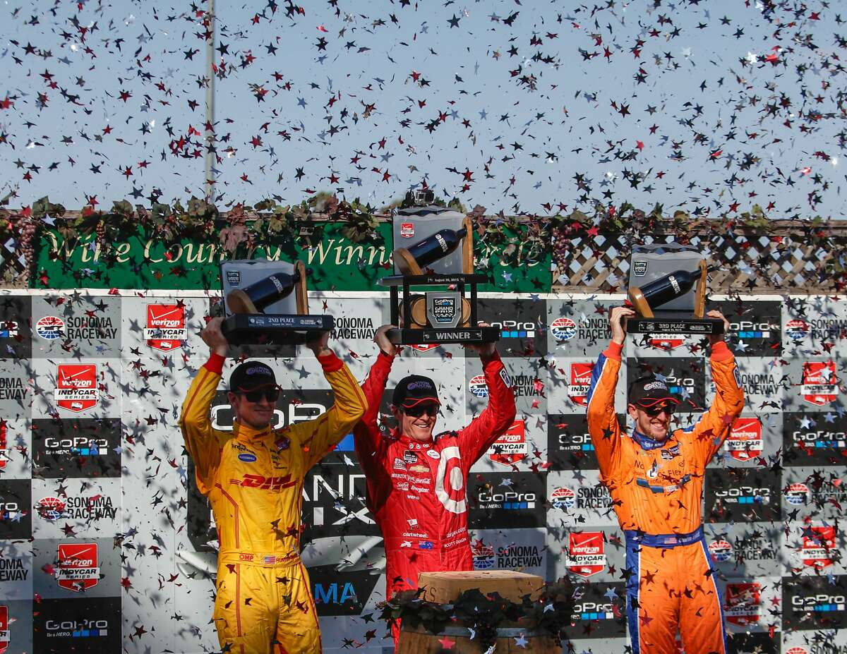 (L-R) Ryan Hunter-Reay, Scott Dixon and Simon Pagenaud raise their trophies during the celebration after the GoPro Grand Prix at Sonoma Raceway on Sunday, Aug. 30, 2015 in Sonoma, Calif. Dixon won this round and earned enough points to elevate himself from third place in The Verizon Indy Car racing series to the champion.