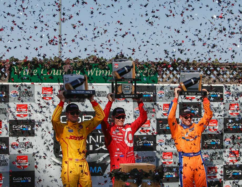 (L-R) Ryan Hunter-Reay, Scott Dixon and Simon Pagenaud raise their trophies during the celebration after the GoPro Grand Prix at Sonoma Raceway on Sunday, Aug. 30, 2015 in Sonoma, Calif.  Dixon won  this round and earned enough points to elevate himself from third place in The Verizon Indy Car racing series to the champion. Photo: Nathaniel Y. Downes, The Chronicle