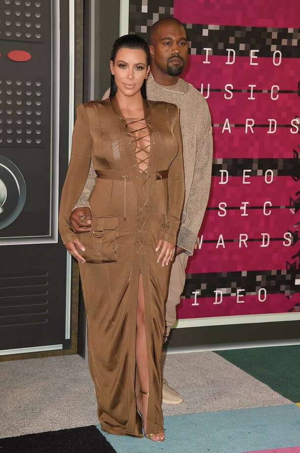 "MTV VMAs style: the good, bad and trashyRapper Kanye West and Kim Kardashian. There are no words. (OK, I'll try: He looks like he crawled out of bed after admittedly smoking marijuana, while she stole Danny Devito's costume from ""Batman Returns."" ) Photo: Steve Granitz, Getty / 2015 Steve Granitz"