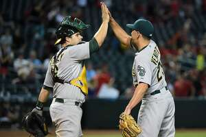Oakland A's prevail in 11th, first win for Pat Venditte - Photo