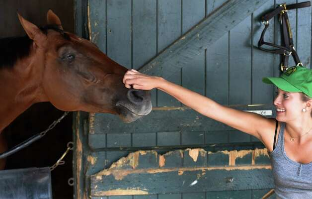 Travers winner Keen Ice gets his nose scratched by his friend Mackenzie Kirker-Head Sunday morning Aug. 30, 2015 at the Romans Racing Stable barns at the Saratoga Race Course in Saratoga Springs, N.Y.    (Skip Dickstein/Times Union) Photo: SKIP DICKSTEIN / 00033110A