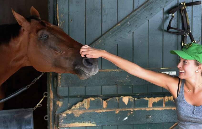 Travers winner Keen Ice gets his nose scratched by his friend Mackenzie Kirker-Head Sunday morning A