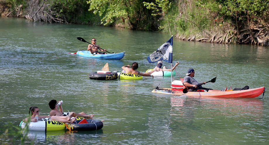 Tubers and kayakers float the San Marcos River while attending Float Fest held at Cool River Ranch Sunday Aug. 30, 2015 in Martindale, Tx. Photo: Photos By Edward A. Ornelas / San Antonio Express-News / © 2015 San Antonio Express-News