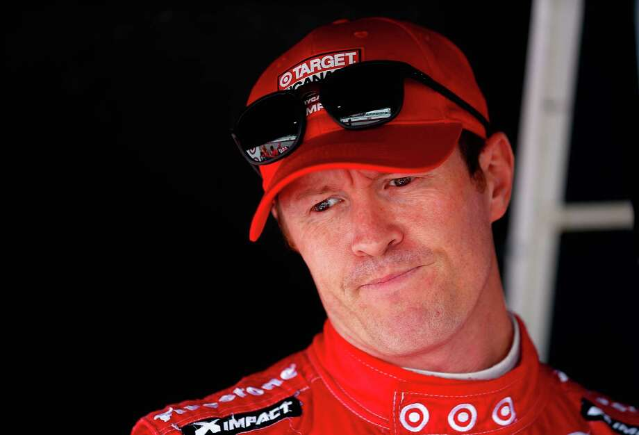 LEXINGTON, OH - AUGUST 01:  Scott Dixon of New Zealand driver of the #9 Target Chip Ganassi Racing Dallara Chevrolet stand in his pit box prior to practice for the Verizon IndyCar Series Honda Indy 200 at Mid-Ohio Sports Car Course on August 1, 2014 in Lexington, Ohio.  (Photo by Chris Trotman/Getty Images) ORG XMIT: 504300323 Photo: Chris Trotman / 2014 Getty Images