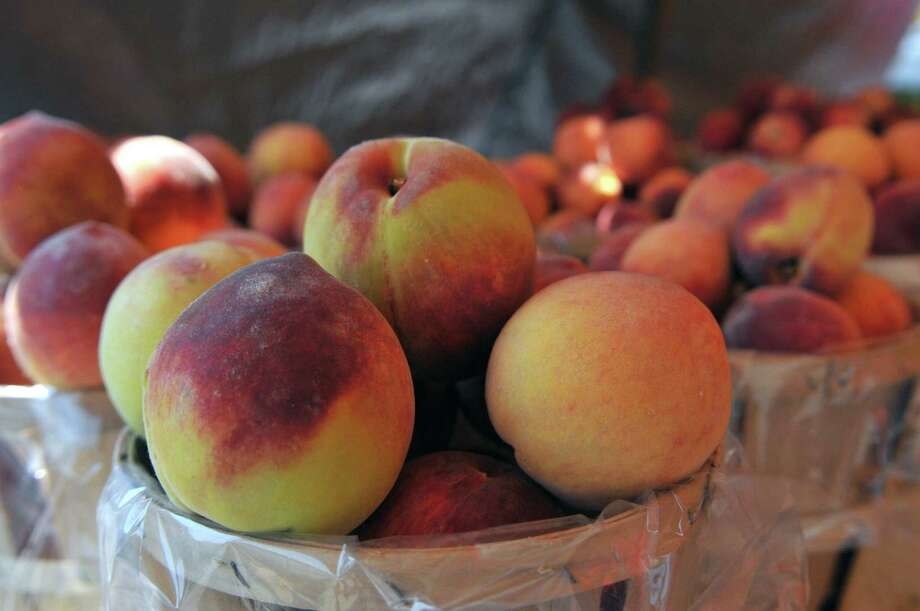 A view of Red Haven peaches for sale on Tuesday, Aug 18, 2015, at Love Apple Farm in Ghent, N.Y. The farm is still recovering from a fire that leveled its store and refrigerated warehouse in 2012. (Phoebe Sheehan/Special to The Times Union) Photo: PS / 00033046A