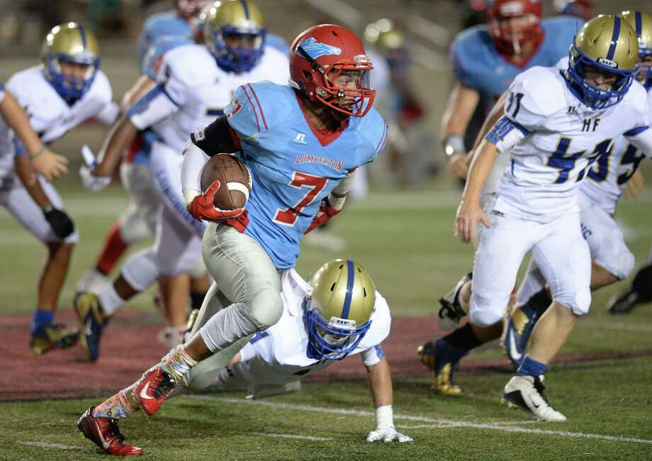 Lumberton's Timothy Rhodes runs the ball against Hampshire-Fannett's defense at Cardinal Stadium during Friday night's match up.   Photo taken Friday, August 28, 2015  Guiseppe Barranco/The Enterprise Photo: Guiseppe Barranco, Photo Editor