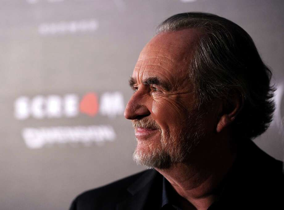 """FILE  AUGUST 30:  Writer/Director Wes Craven, best known for horror franchises Nightmare on Elm Street and Scream died on August 30, 2015. He was battling brain cancer. HOLLYWOOD, CA - APRIL 11:  Director Wes Craven arrives at the premiere of the Weinstein Company's """"Scream 4"""" Presented by AXE Shower at Grauman's Chinese Theatre on April 11, 2011 in Hollywood, California.  (Photo by Frazer Harrison/Getty Images) Photo: Frazer Harrison, Staff / 2011 Getty Images"""