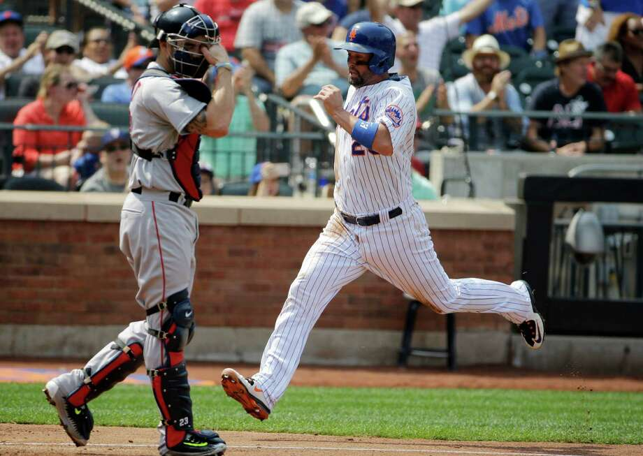 New York Mets' Michael Cuddyer, right, scores on Noah Syndergaard's second-inning RBI-single in an interleague baseball game against the Boston Red Sox in New York, Sunday, Aug. 30, 2015. (AP Photo/Kathy Willens) ORG XMIT: NYM109 Photo: Kathy Willens / AP