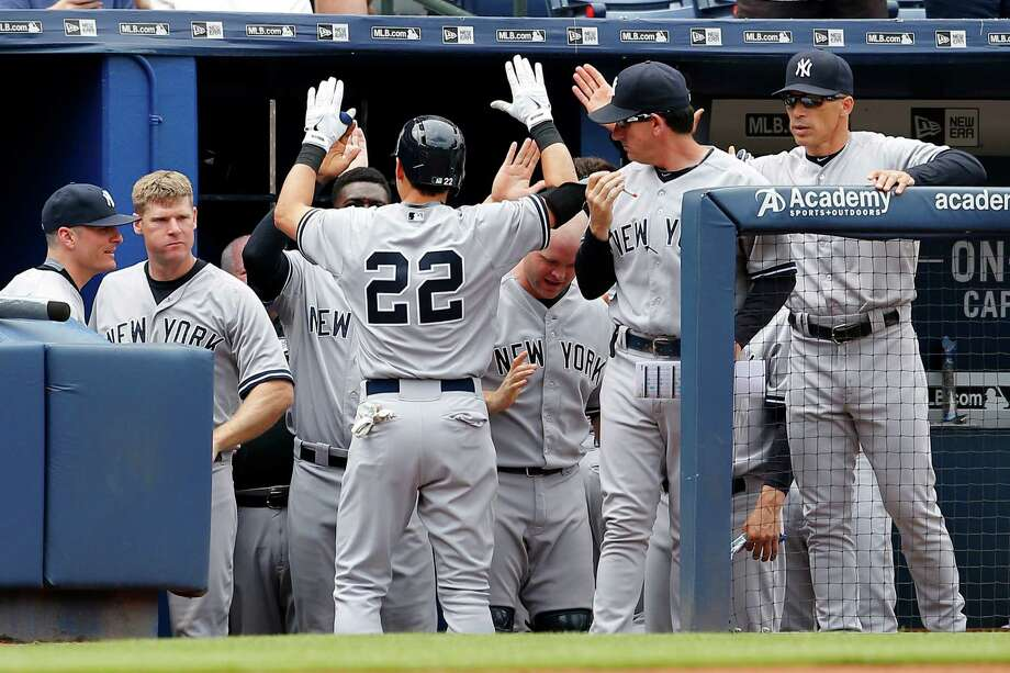 New York Yankees' Jacoby Ellsbury (22) celebrates with teammates after a three-run home run in the second inning of a baseball game against the Atlanta Braves, Sunday, Aug. 30, 2015, in Atlanta. (AP Photo/Todd Kirkland) ORG XMIT: GATK108 Photo: Todd Kirkland / FR170762 AP