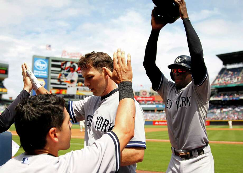 New York Yankees' Stephen Drew, center, celebrates a two-run home run as Didi Gregorius lifts his helmet in the third inning of a baseball game against the Atlanta Braves, Sunday, Aug. 30, 2015, in Atlanta. (AP Photo/Todd Kirkland) ORG XMIT: GATK110 Photo: Todd Kirkland / FR170762 AP
