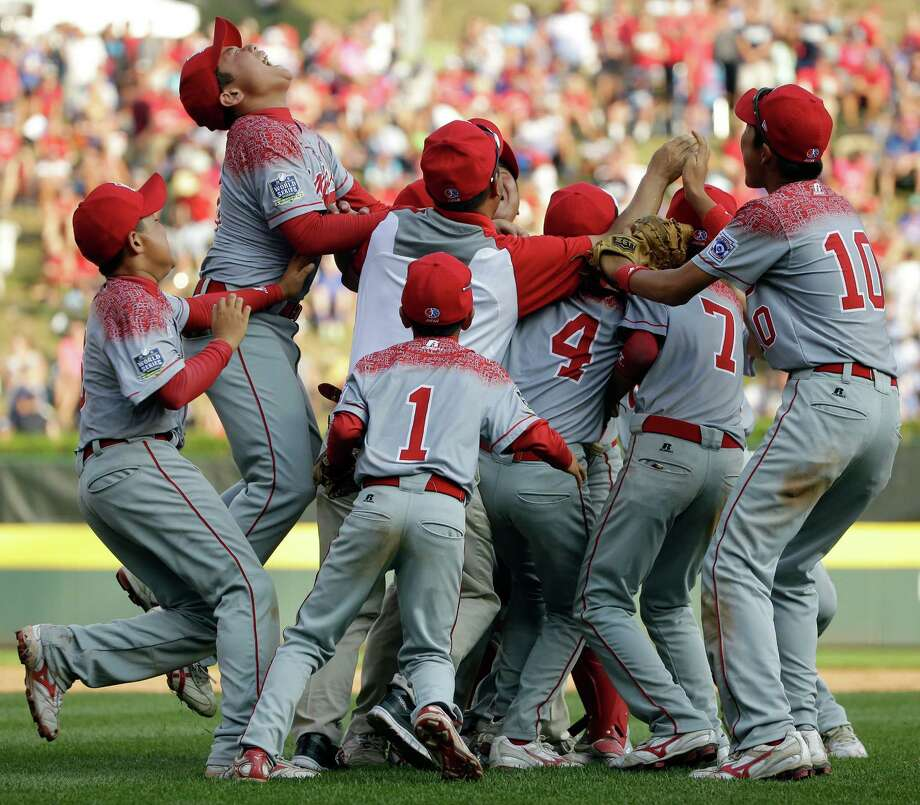 Japan celebrates after winning the Little League World Series Championship baseball game against Lewisberry, Pa., Sunday, Aug. 30, 2015, in South Williamsport, Pa. Japan won 18-11. (AP Photo/Matt Slocum) ORG XMIT: PAMS125 Photo: Matt Slocum / AP