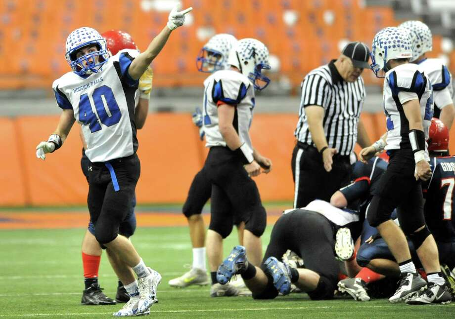 Hoosick Falls' Connor McCart, left, indicates his team has the ball following a fumble by Chenango Forks during their Class C state football final on Saturday Nov. 29, 2014, at the Carrier Dome in Syracuse, N.Y. (Cindy Schultz / Times Union) Photo: Cindy Schultz / 00029661A