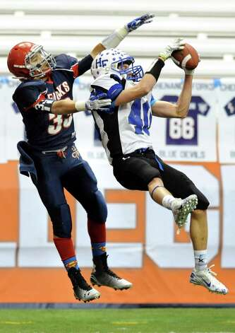 Hoosick Falls' Connor McCart, right, catches a pass to set up a touchdown as Chenango Forks' L. J. Watson defends during their Class C state football final on Saturday Nov. 29, 2014, at the Carrier Dome in Syracuse, N.Y. (Cindy Schultz / Times Union) Photo: Cindy Schultz / 00029661A