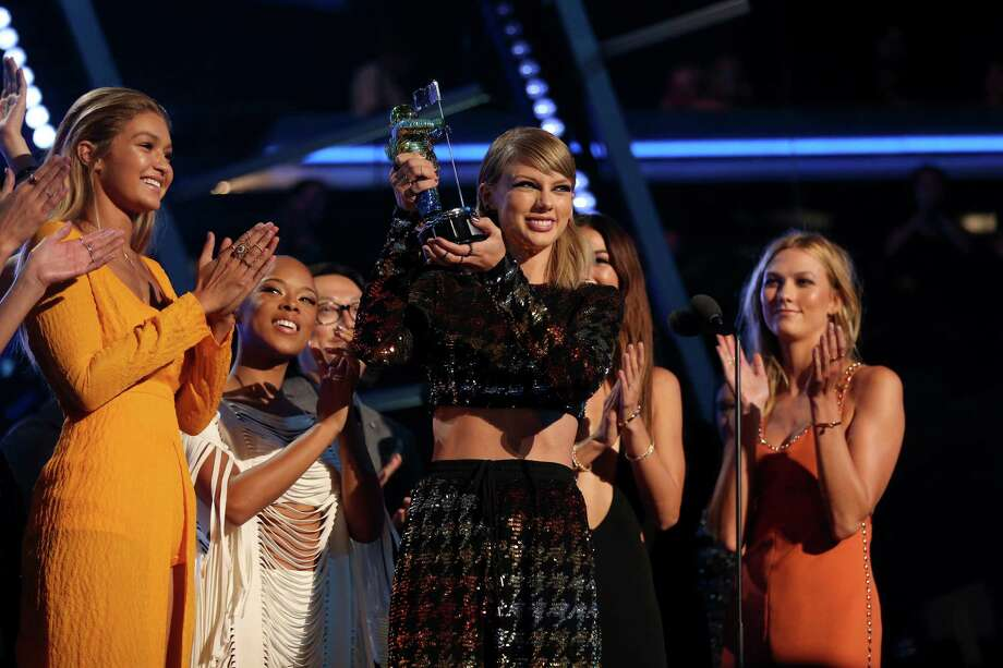 "LOS ANGELES, CA - AUGUST 30: Recording artist Taylor Swift accepts the Video of the Year award for ""Bad Blood"" onstage during the 2015 MTV Video Music Awards at Microsoft Theater on August 30, 2015 in Los Angeles, California. Photo: Christopher Polk/MTV1415, Getty / 2015 Christopher Polk/MTV1415"