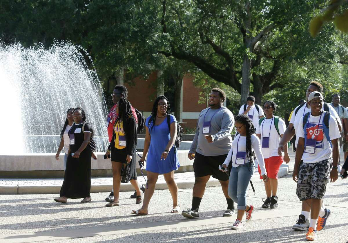 Students walk on the campus of Prairie View A&M University, Tuesday, July 28, 2015 in Prairie View.