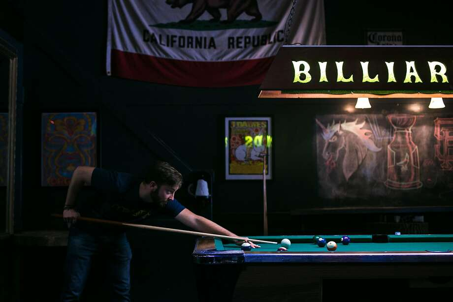 Keith Grose lines up his shot at the Square in North Beach. The casual dining spot has a pool table, TVs and more casual food. Photo: Jen Fedrizzi, Special To The Chronicle