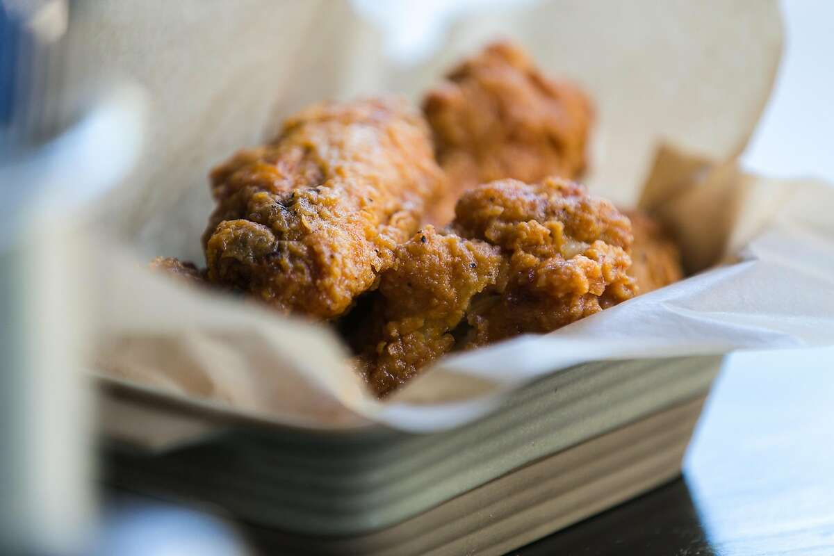 Hot chicken wings freshly prepared at The Square in North Beach.