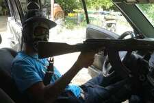 El Blog Del Narco published more than 30 photos on Monday of purported Gulf Cartel members showing their faces and guns.