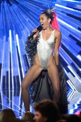LOS ANGELES, CA - AUGUST 30:  Host Miley Cyrus holding a Samsung phone speaks onstage during the 2015 MTV Video Music Awards at Microsoft Theater on August 30, 2015 in Los Angeles, California.  (Photo by Kevork Djansezian/Getty Images)