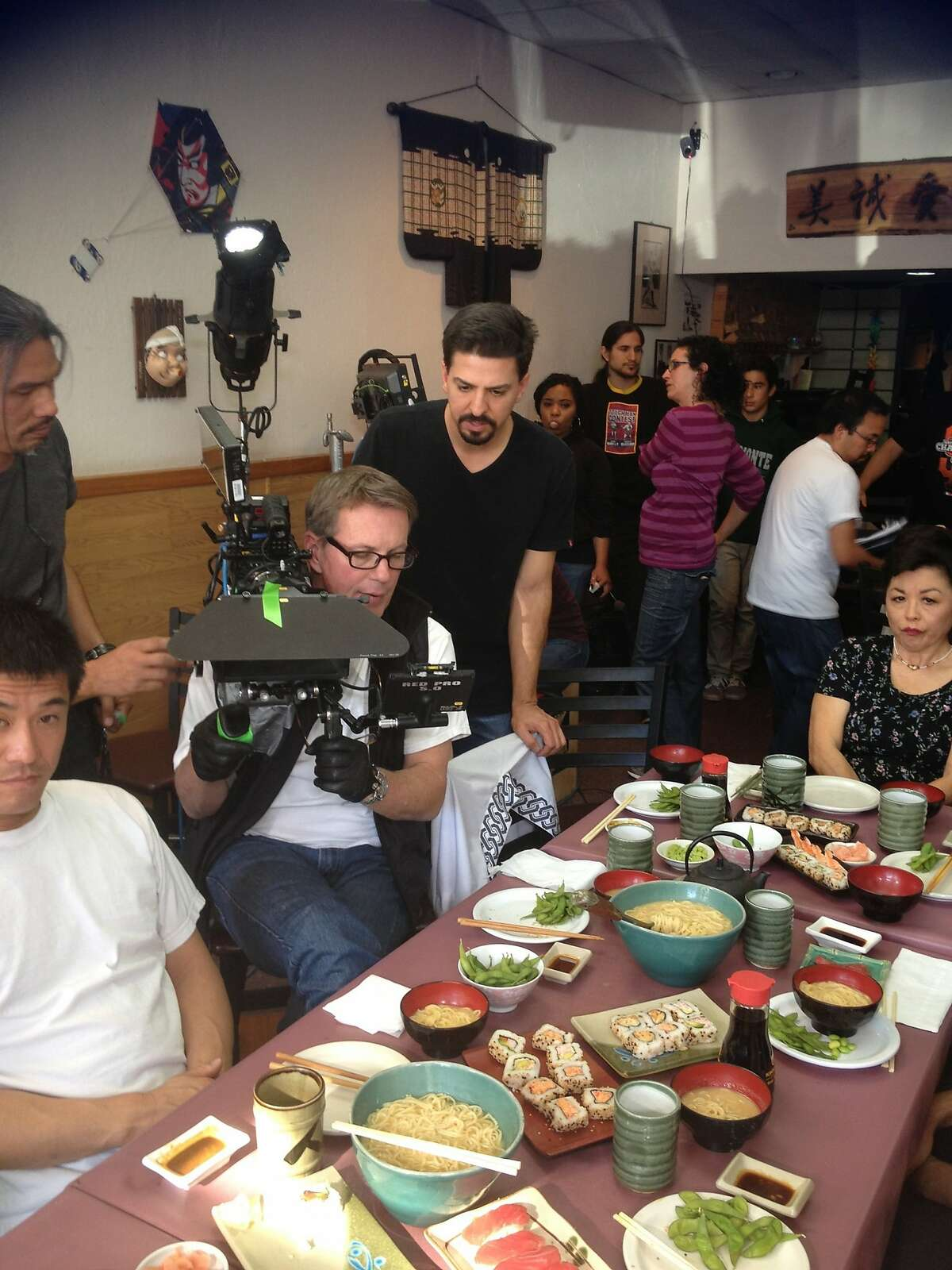 """East Side Sushi 1.jpg East Side Sushi 2.jpg Cinematographer Marty Rosenberg (left) with writer/director Anthony Lucero on the set of """"East Side Sushi."""" """"East Side Sushi"""" opens in Bay Area theaters on Friday, September 18."""