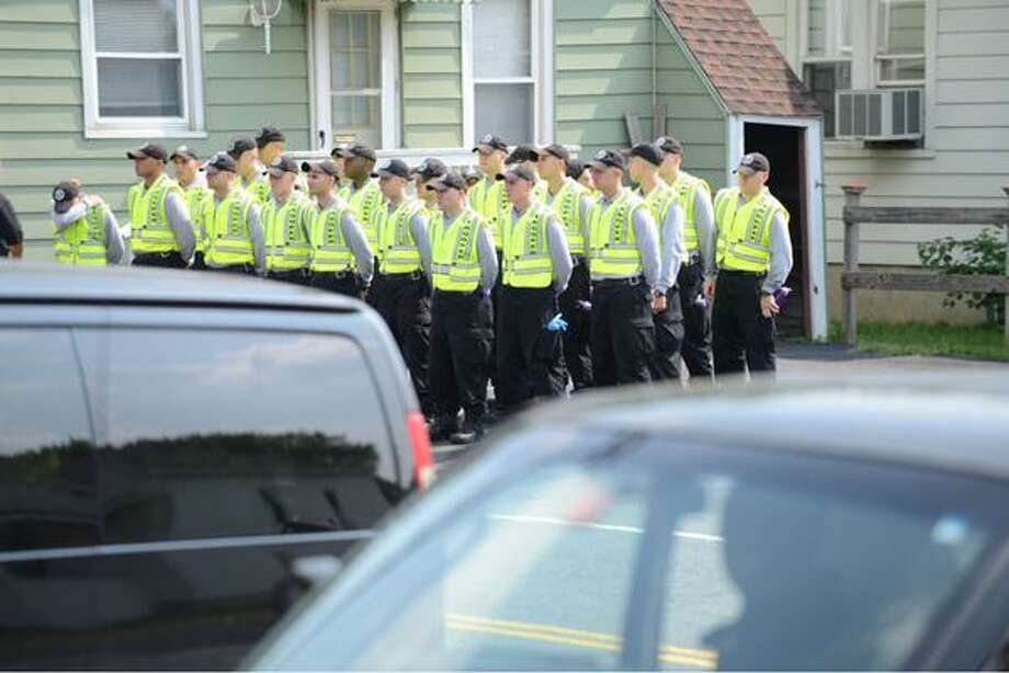 Recruits from the State Police prepare Monday to search an area near where hair stylist Jacquelyn Porreca was killed on Aug. 21. (Will Waldron / Times Union)