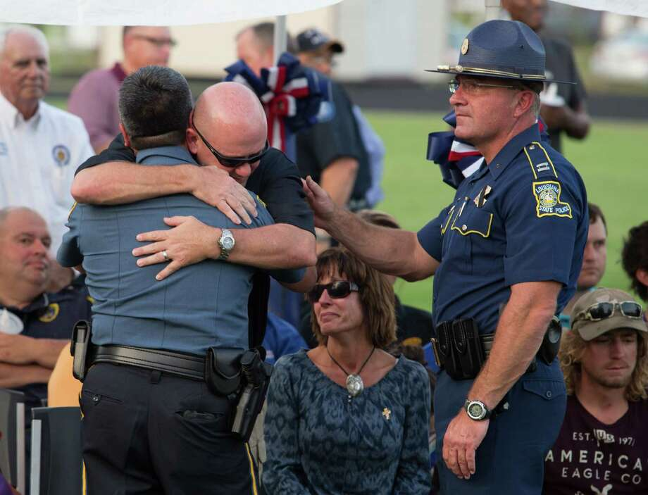 A memorial service took place in honor of La. State Trooper Steven Vincent's home town of Iowa, La., Tuesday, Aug. 25, 2015, at the Iowa High School football stadium. Vincent succumbed to his injuries yesterday morning after he was shot by Kevin Dangle during the course of a traffic incident Sunday, Aug. 23, 2015.  (Kirk Meche/American Press via AP) Photo: Kirk Meche, MBO / American Press