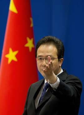 "Foreign ministry spokesman Hong Lei gestures during a daily briefing at the Ministry of Foreign Affairs office in Beijing, China Tuesday, May 20, 2014. China on Tuesday warned the United States was jeopardizing military ties by charging five Chinese officers with cyberspying and tried to turn the tables on Washington by calling it ""the biggest attacker of China's cyberspace."" (AP Photo/Andy Wong)"