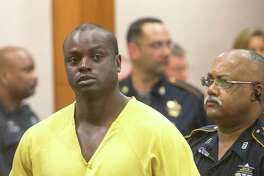 """Shannon Miles appears in the 208th State District Court for his arraignment at the Harris County Criminal Courthouse, Monday, Aug. 31, 2015, in Houston. Harris County District Attorney Devon Anderson said Miles, 30, fatally shot Deputy Darren Goforth after he refueled his police cruiser at a gas station. """"They found Deputy Darren Goforth face down in a pool of his own blood,"""" Harris County District Attorney Devon Anderson told state District Judge Denise Collins."""