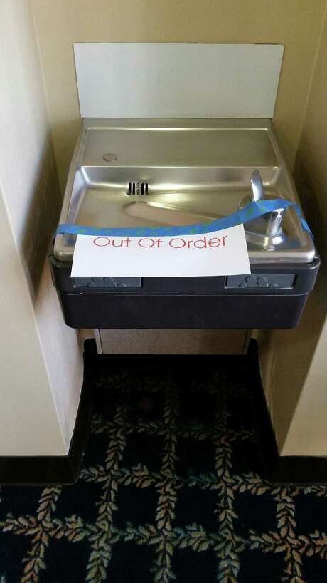 """Out of order"" signs appeared on water fountains at the U.S. courthouse in San Antonio after tests found high levels of lead in the building's water. Photo: Guillermo Contreras /San Antonio Express-News / San Antonio Express-News"