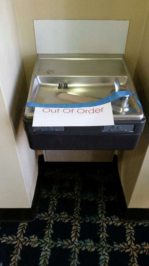 """""""Out of order"""" signs appeared on water fountains at the U.S. courthouse in San Antonio after tests found high levels of lead in the building's water. Photo: Guillermo Contreras /San Antonio Express-News / San Antonio Express-News"""