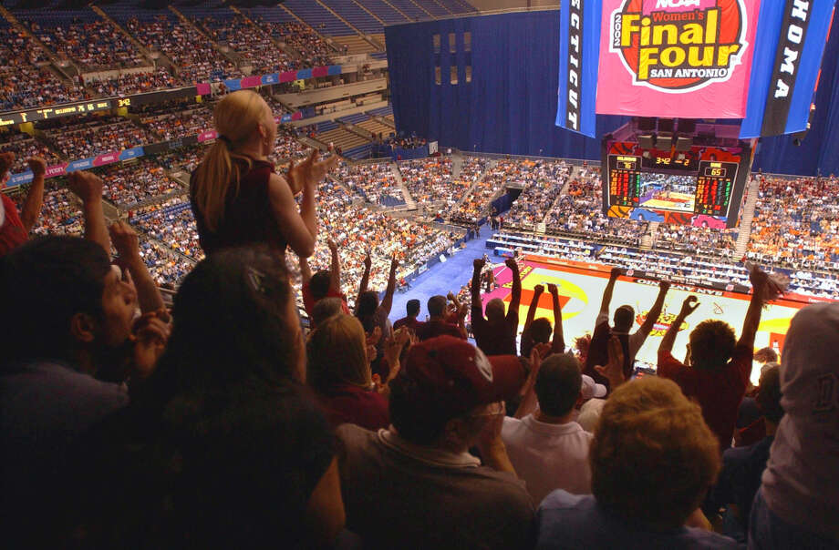 Thousands of fans root for their teams at the end of the second half of the matchup between Duke and Oklahoma during the NCAA Women's Final Four at the Alamodome in San Antonio on March 29, 2002. Photo: Express-News File Photo / SAN ANTONIO EXPRESS-NEWS