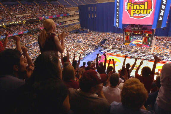 Thousands of fans root for their teams at the end of the second half of the matchup between Duke and Oklahoma during the NCAA Women's Final Four at the Alamodome in San Antonio on March 29, 2002.