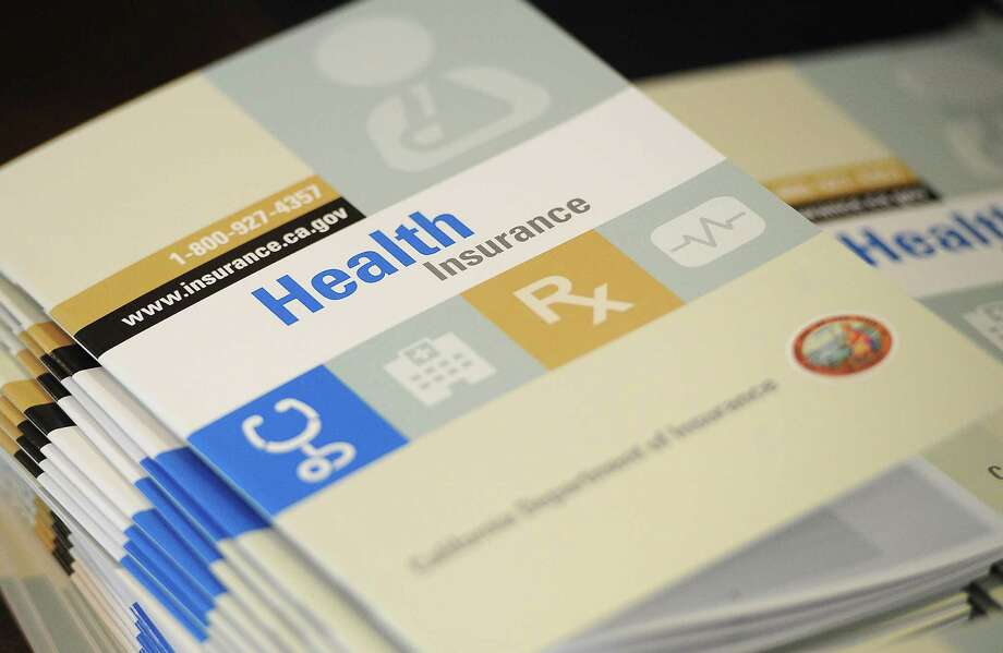 Booklets outlining health insurance options Photo: ROBYN BECK /AFP /Getty Images / AFP